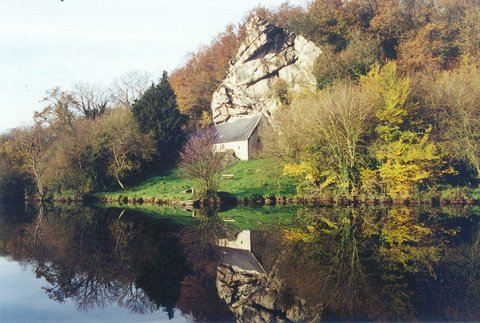 At the foot of the hill on the right bank of a river of Brittany, a chapel  dedicated to St Gildas is as if hewn out of the rock itself...